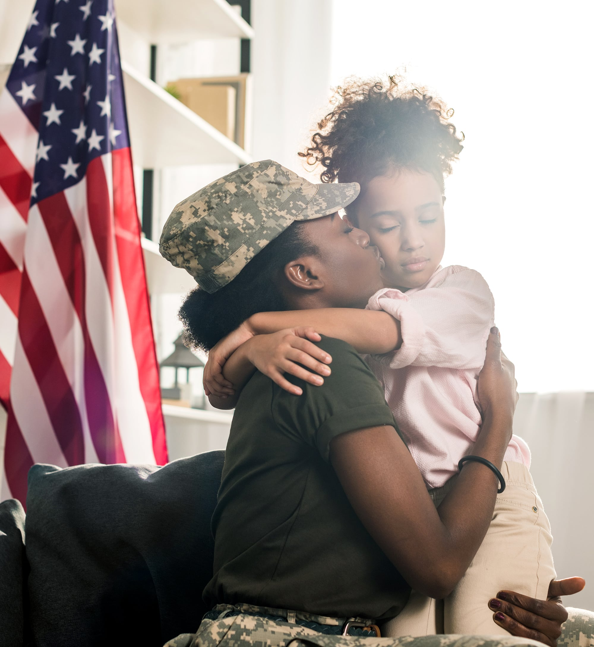 Female Military Service Member with Daughter